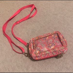 Lanyard pouch with floral print.